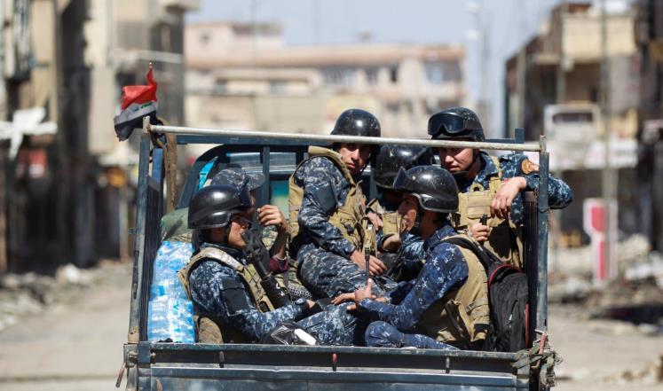 عناصر من الشرطة الاتحادية العراقية التي تخوض معارك مع تنظيم الدولة في الموصل (رويترز)